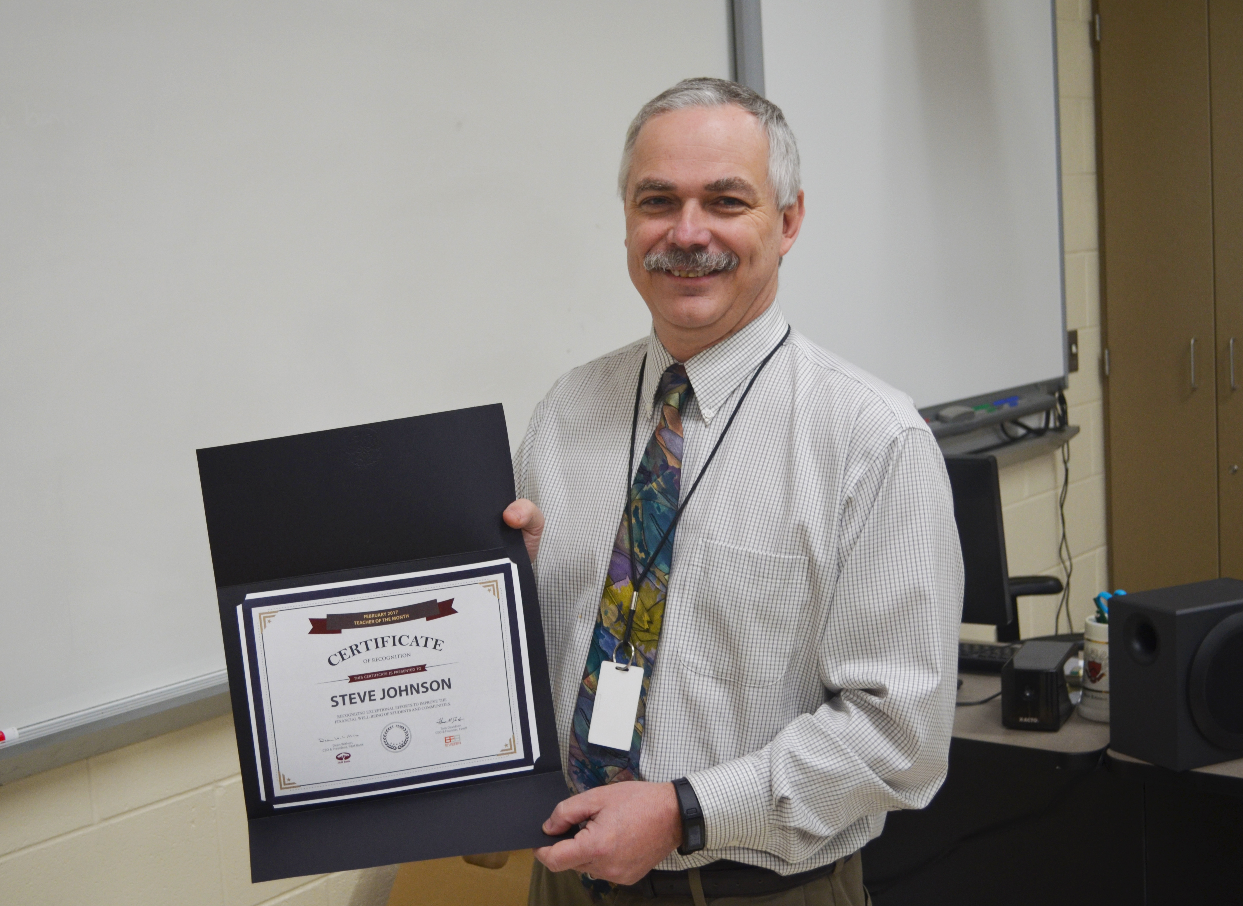 Photo of Luray High School teacher Steve Johnson with his Teacher of the Month certificate