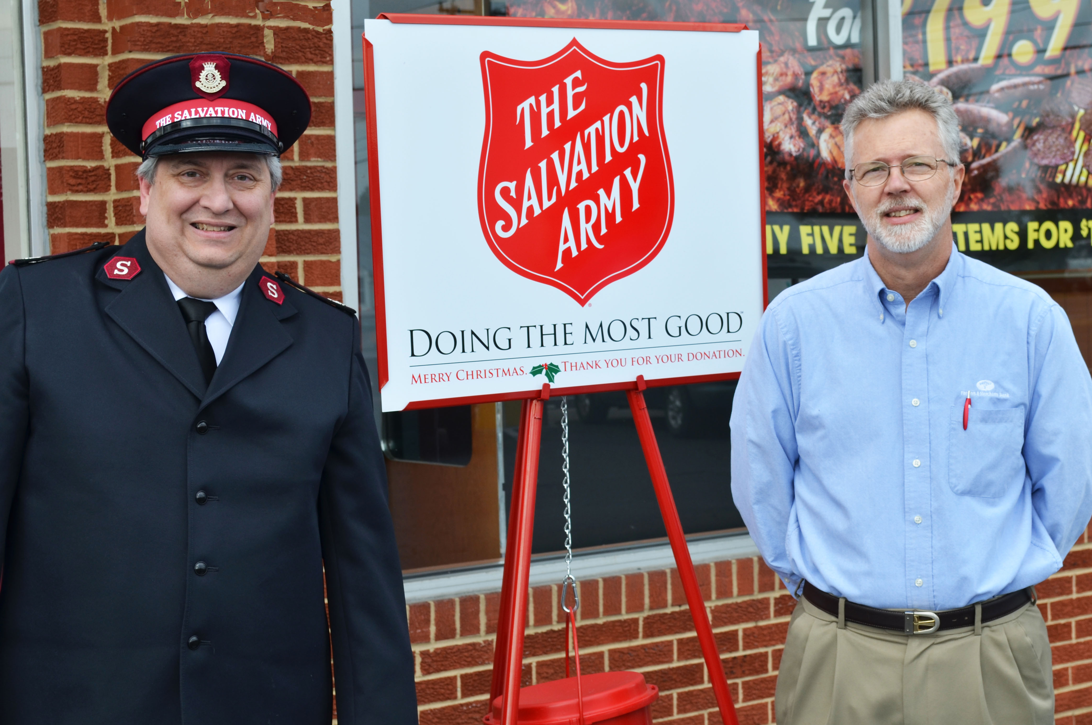 Major Hank Harwell of the Salvation Army and F&M Bank EVP Neil Hayslett