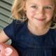 Girl holds piggy bank
